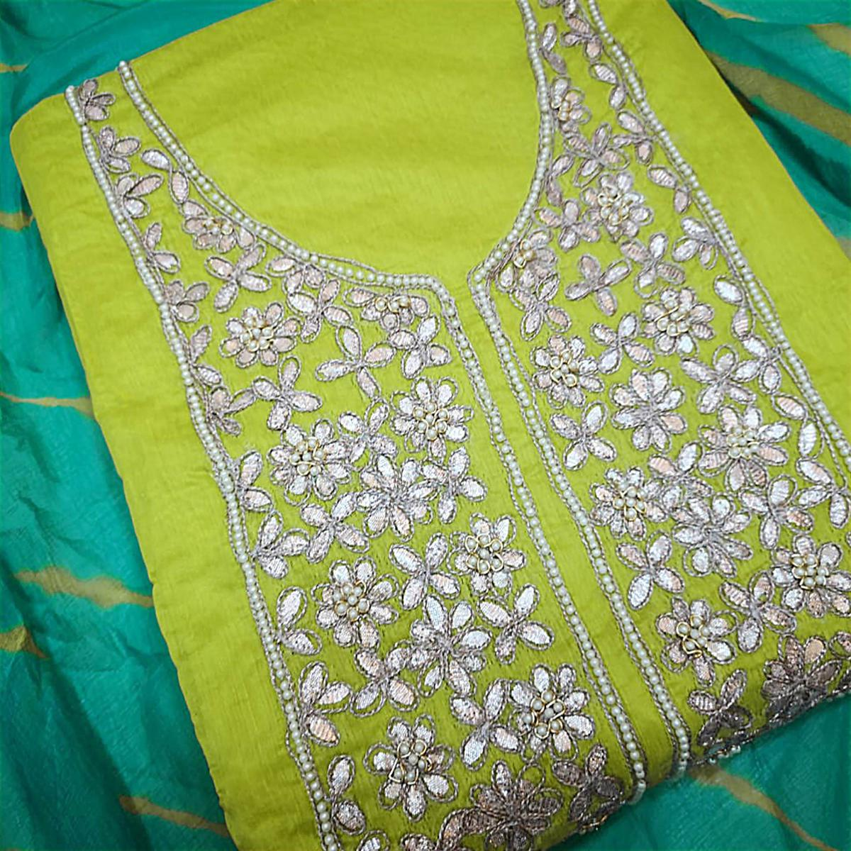 Unique Green Colored Partywear Embroidered Modal Dress Material
