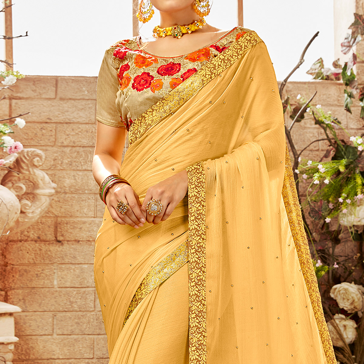 Appealing Yellow Colored Party Wear Embroidered Georgette Saree