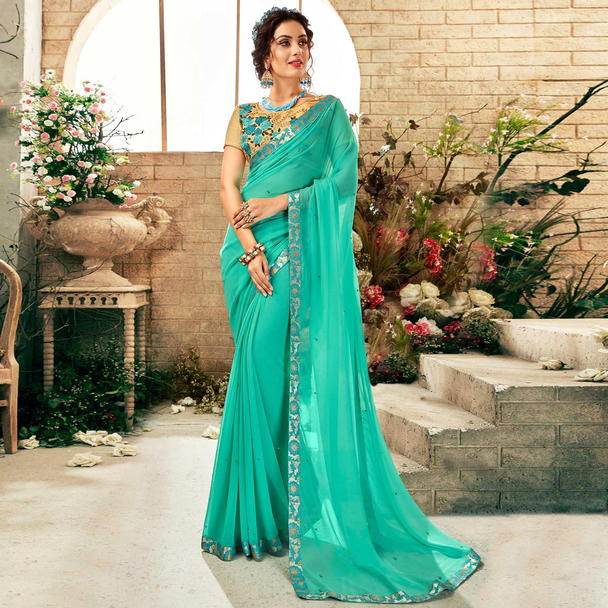 Mesmeric Turquoise Colored Party Wear Embroidered Georgette Saree