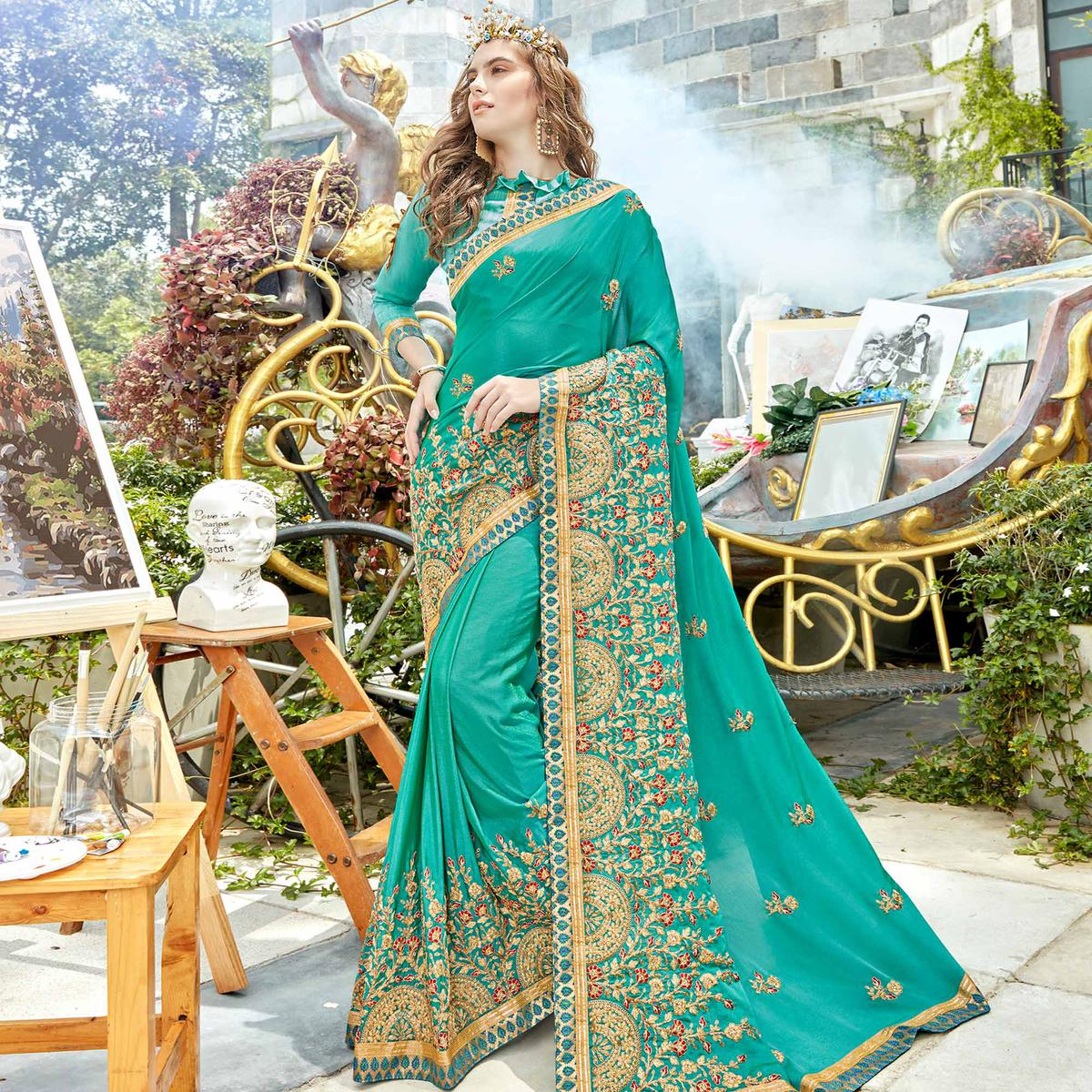 Mesmerising Turquoise Colored Party Wear Embroidered Georgette Saree