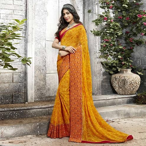 Unique Dark Yellow Colored Partywear Printed Georgette Saree
