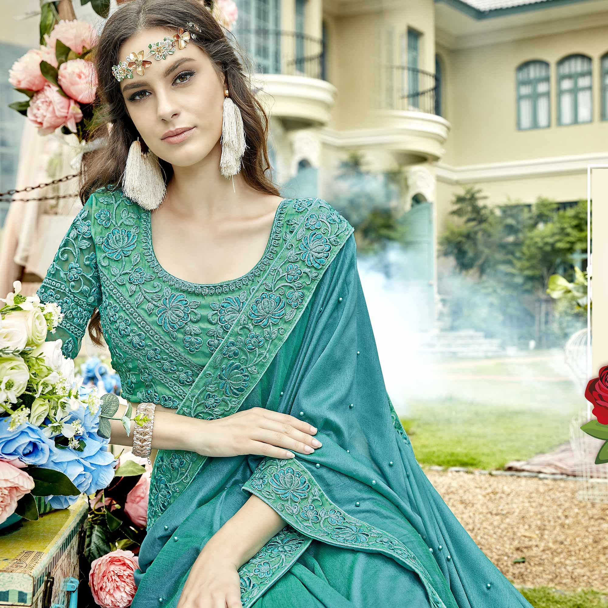 Unique Sky Blue Colored Party Wear Embroidered Georgette Saree
