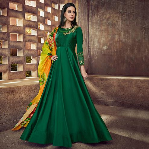 Stunning Green Colored Partywear Embroidered Tapeta Silk Anarkali Suit