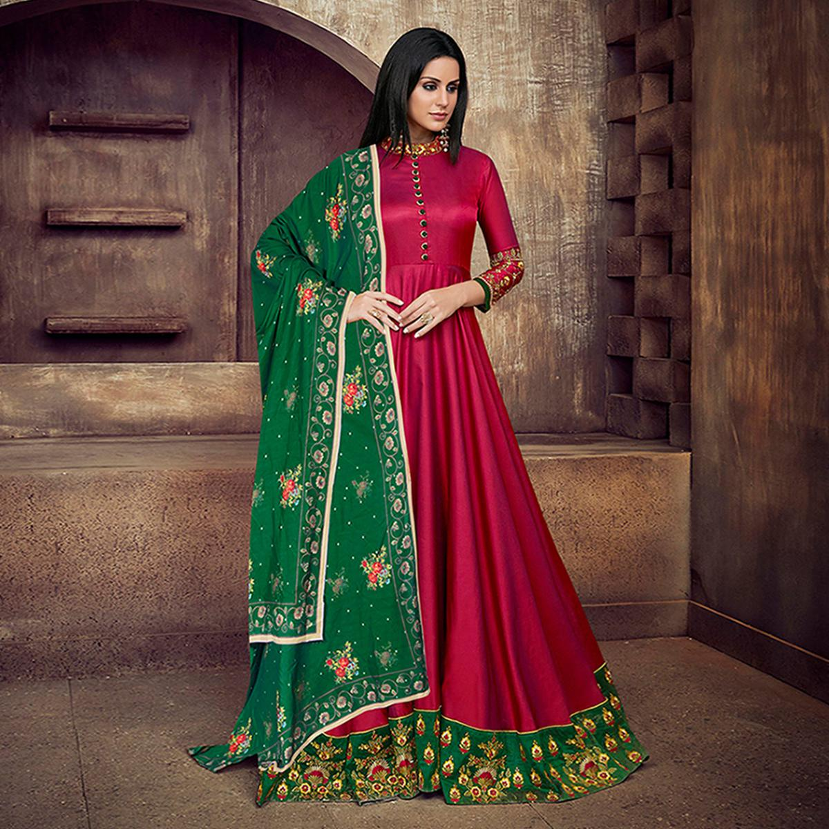 Amazing Deep Pink Colored Partywear Embroidered Tapeta Silk Anarkali Suit