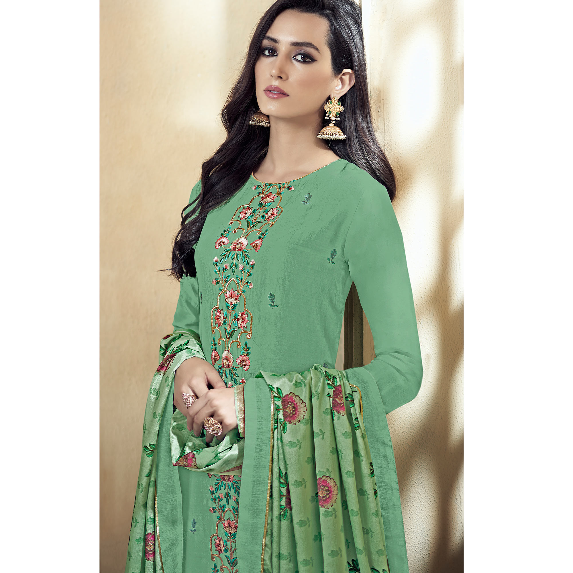 Innovative Green Colored Partywear Embroidered Uppada Silk Palazzo Suit