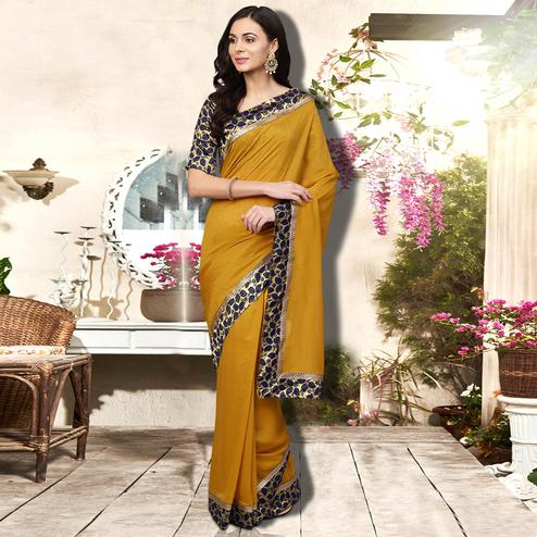 Opulent Mustard Colored Festive Wear Printed Silk Saree