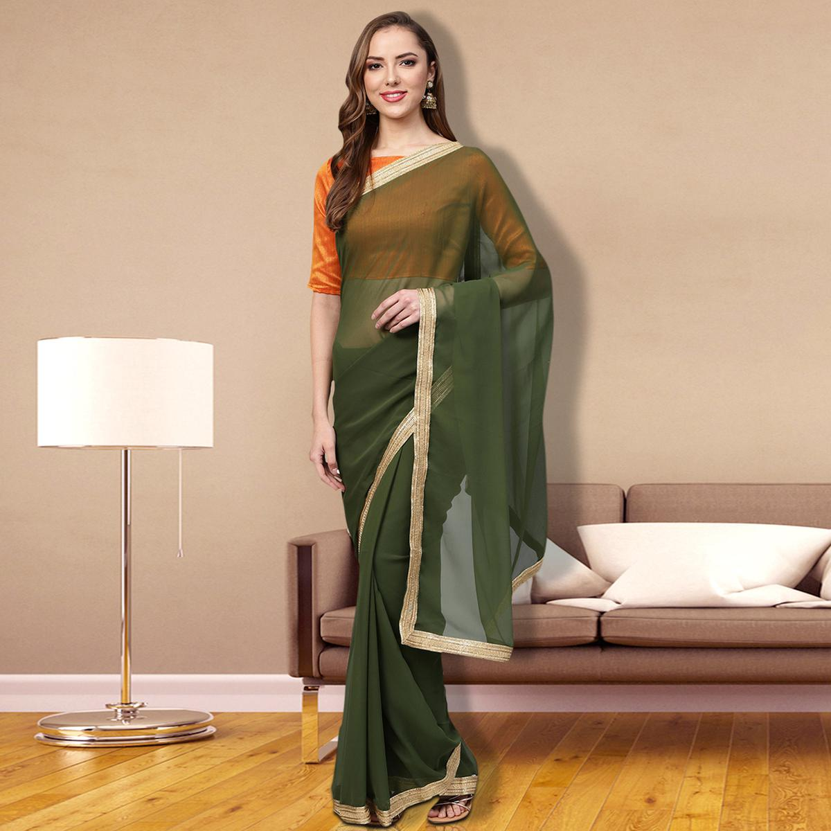 Eye-Catching Green Colored Partywear Georgette Saree