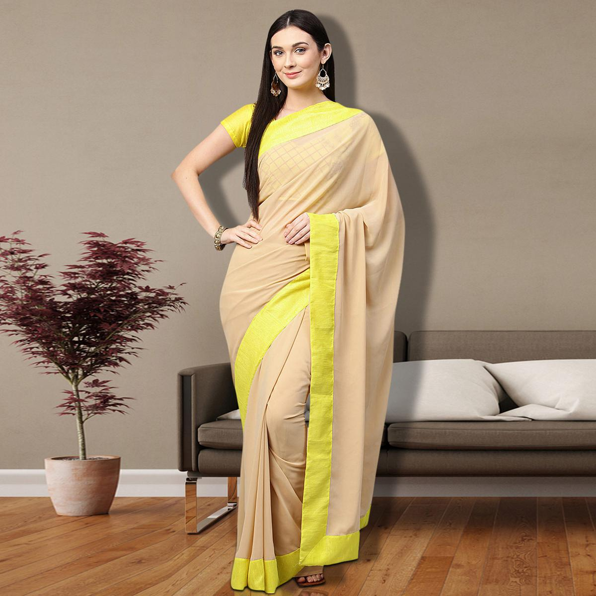 Stunning Beige Colored Partywear Georgette Saree