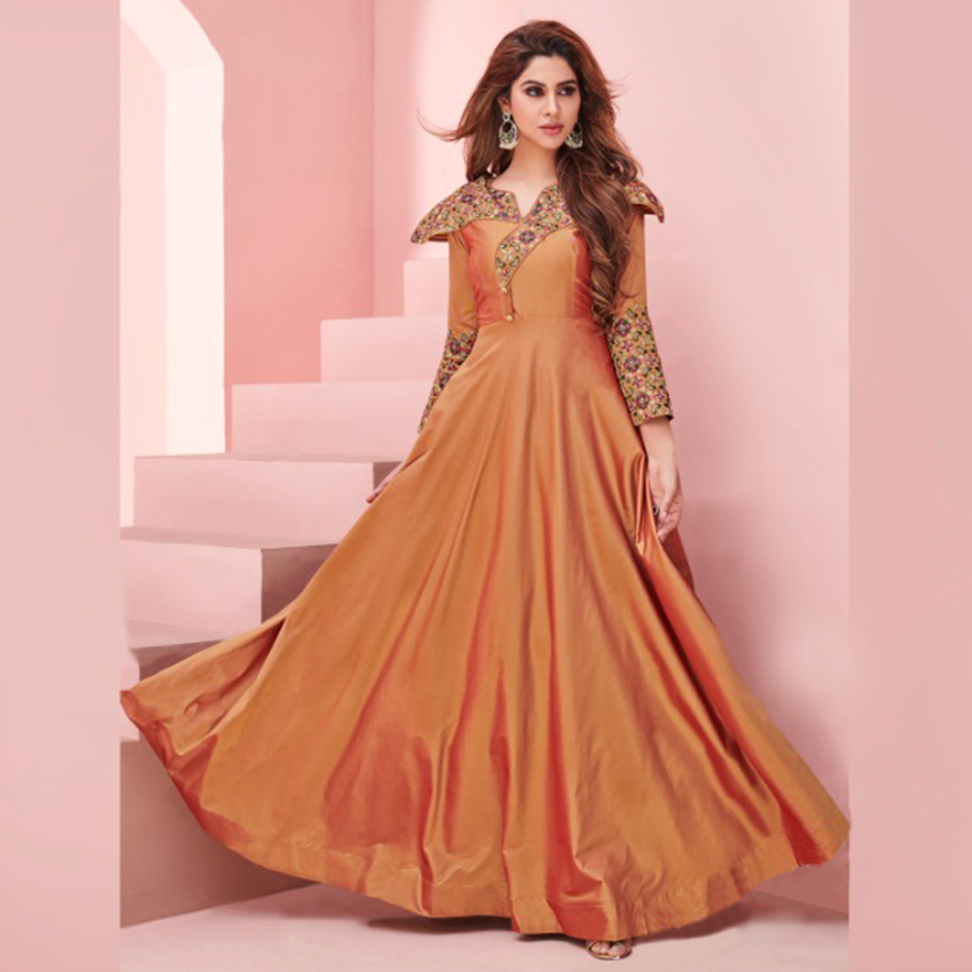 Magnetic Light Orange Colored Party Wear Embroidered Silk Gown