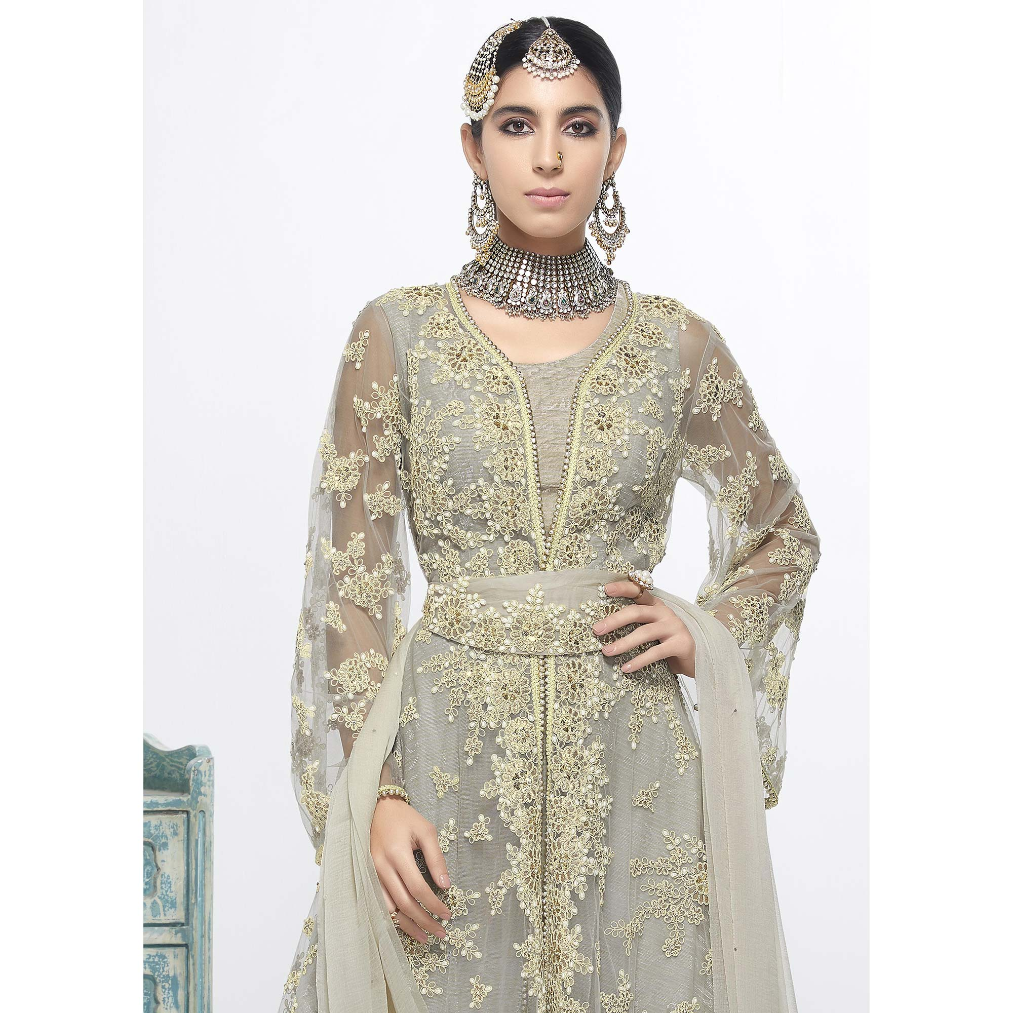 Intricate Grey Colored Party Wear Embroidered Net Salwar Suit