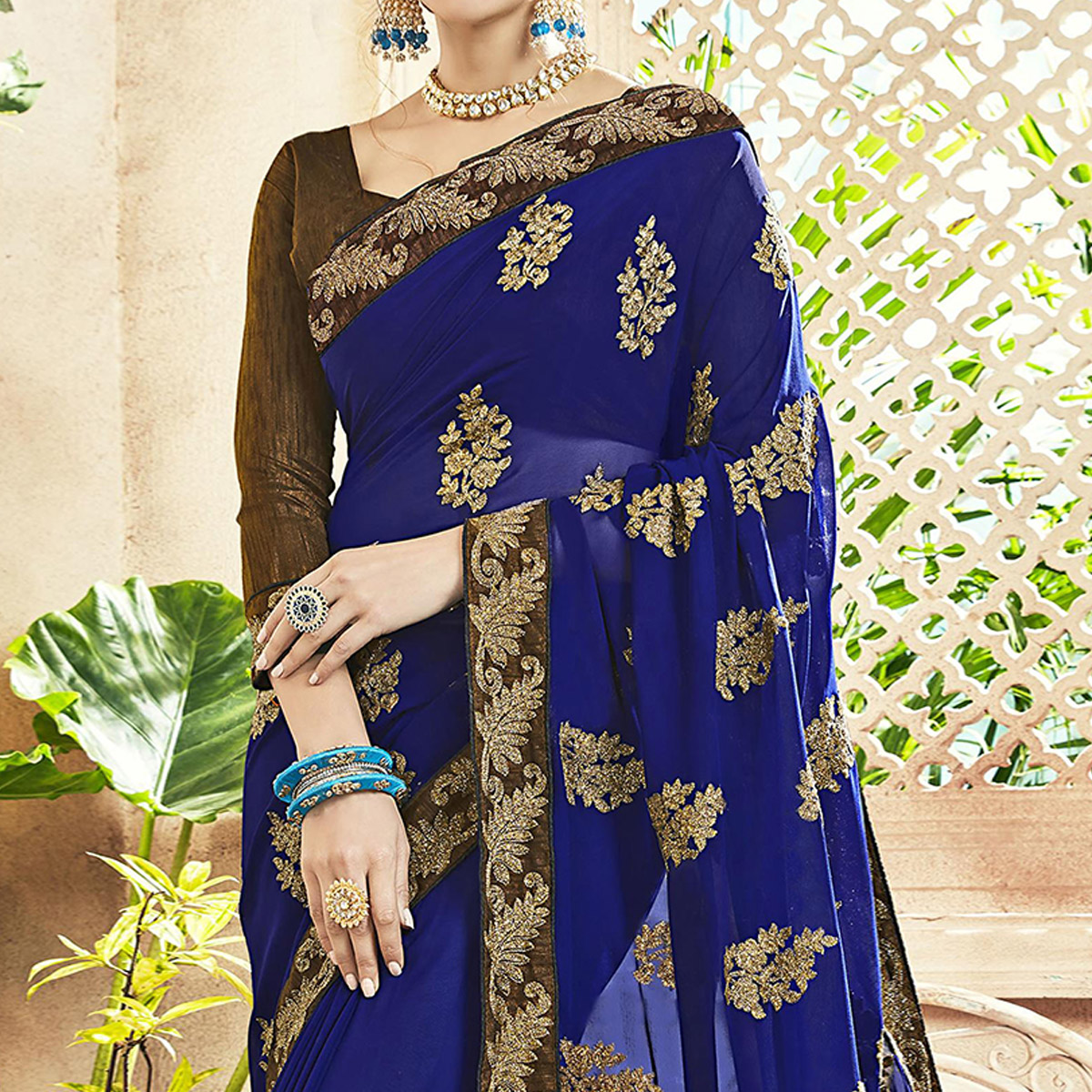 Adorable Blue Colored Party Wear Embroidered Georgette Saree