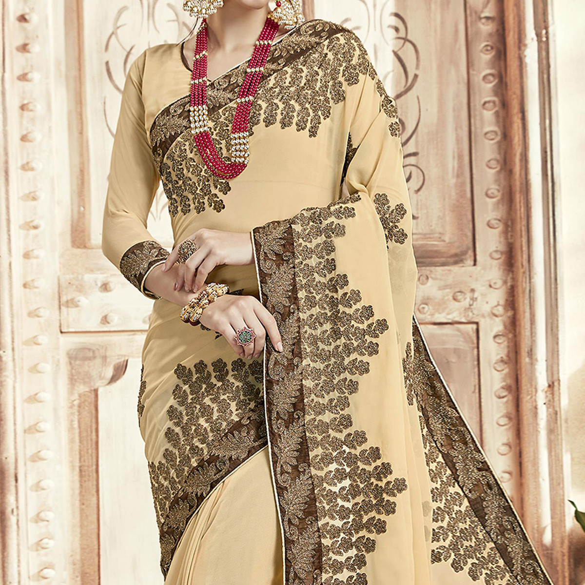 Classy Cream Colored Party Wear Embroidered Georgette Saree
