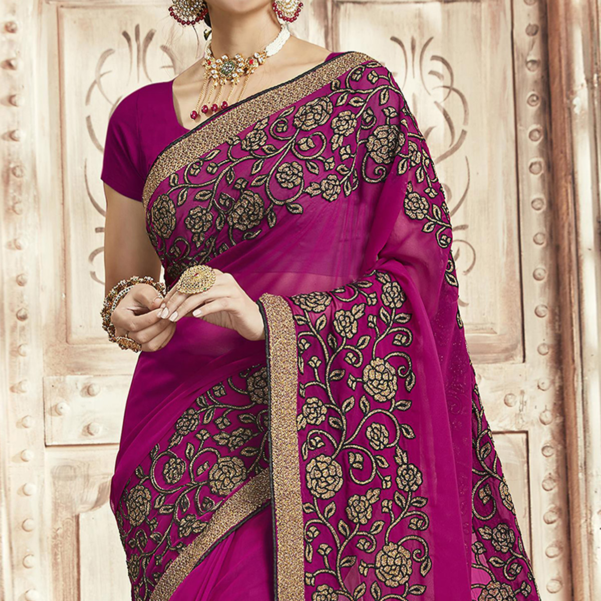 Graceful Magenta Pink Colored Party Wear Embroidered Georgette Saree