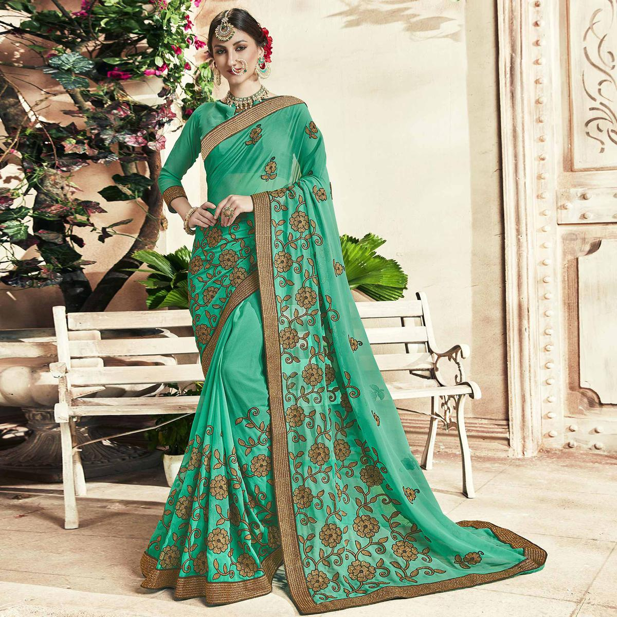 Charming Turquoise Colored Party Wear Embroidered Georgette Saree