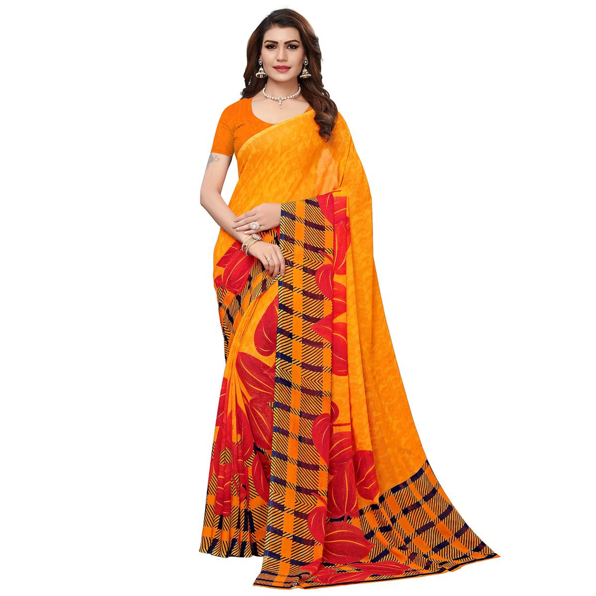 Opulent Orange Colored Casual Wear Printed Georgette Saree