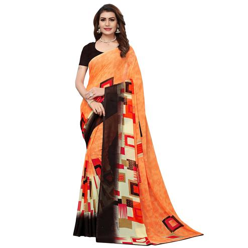 Breathtaking Peach Colored Casual Wear Printed Georgette Saree