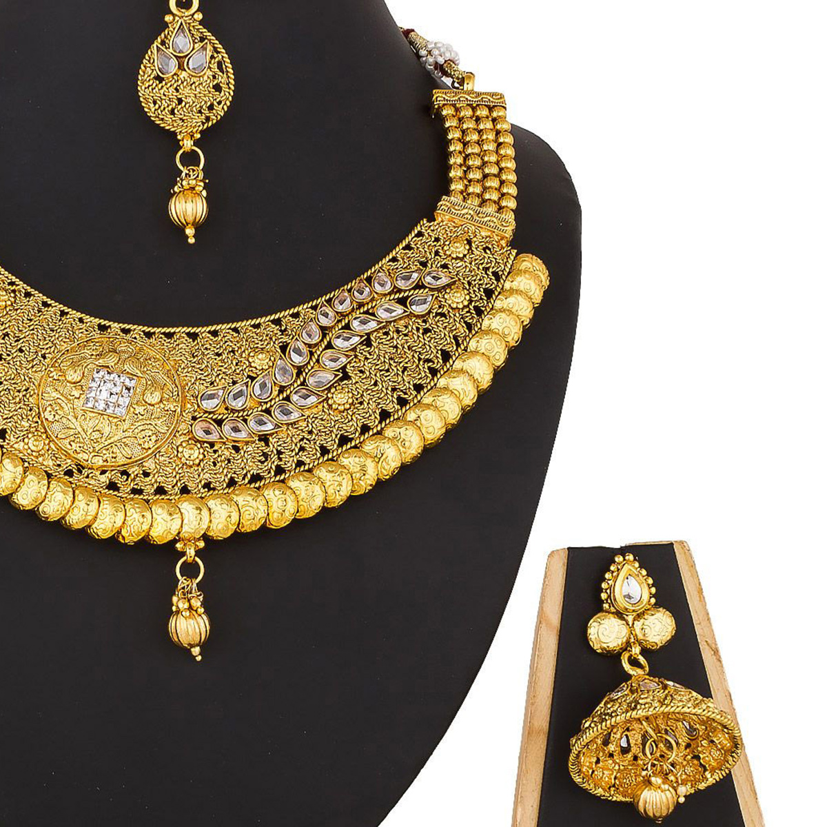 Refreshing Golden Colored Festive Wear Stone Work Mix Metal Necklace Set