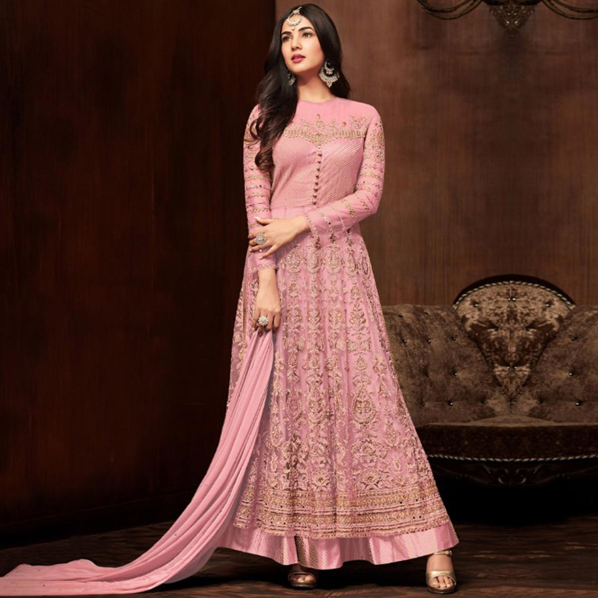 Stunning Pink Colored Partywear Embroidered Netted Lehenga Kameez