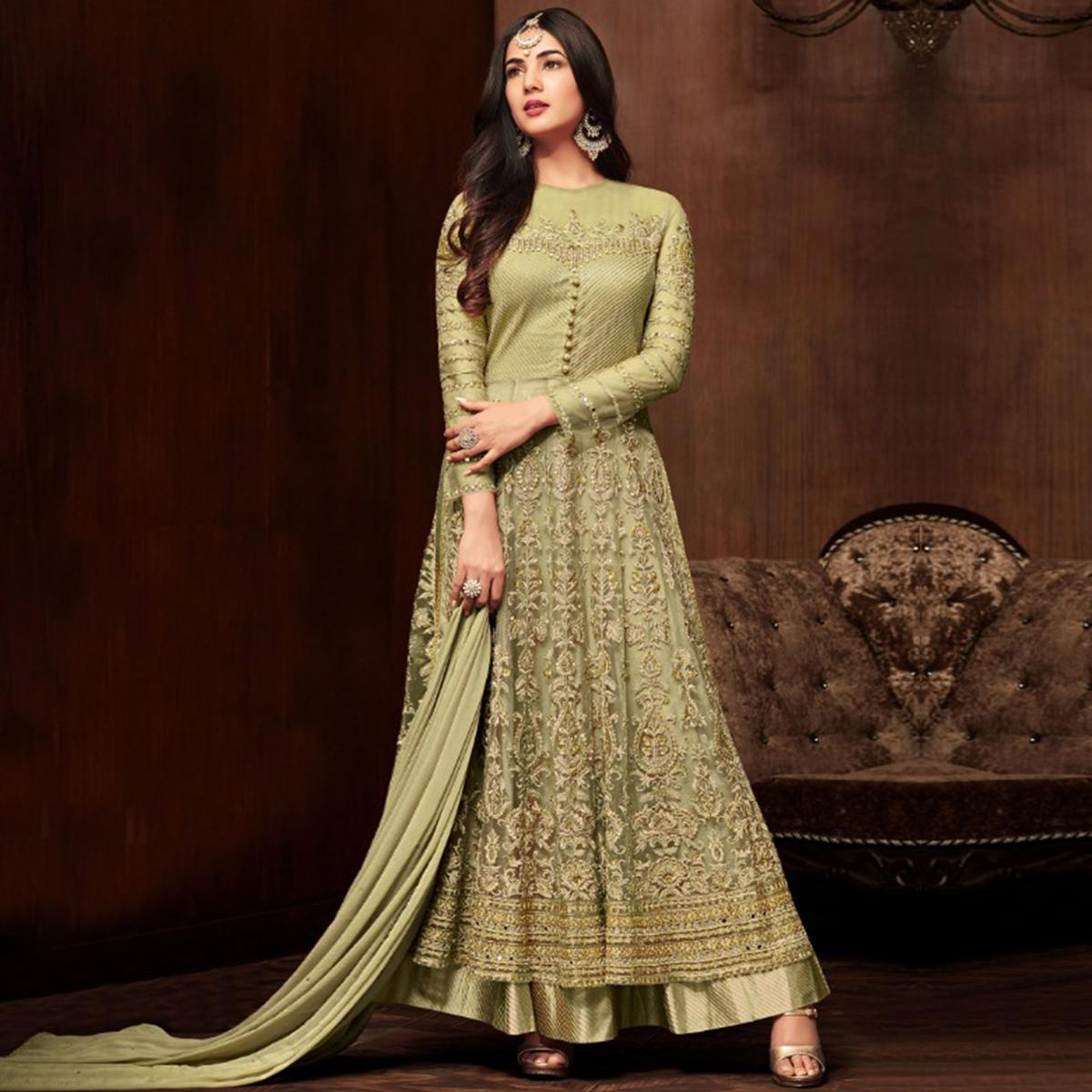 Marvellous Green Colored Partywear Embroidered Netted Lehenga Kameez