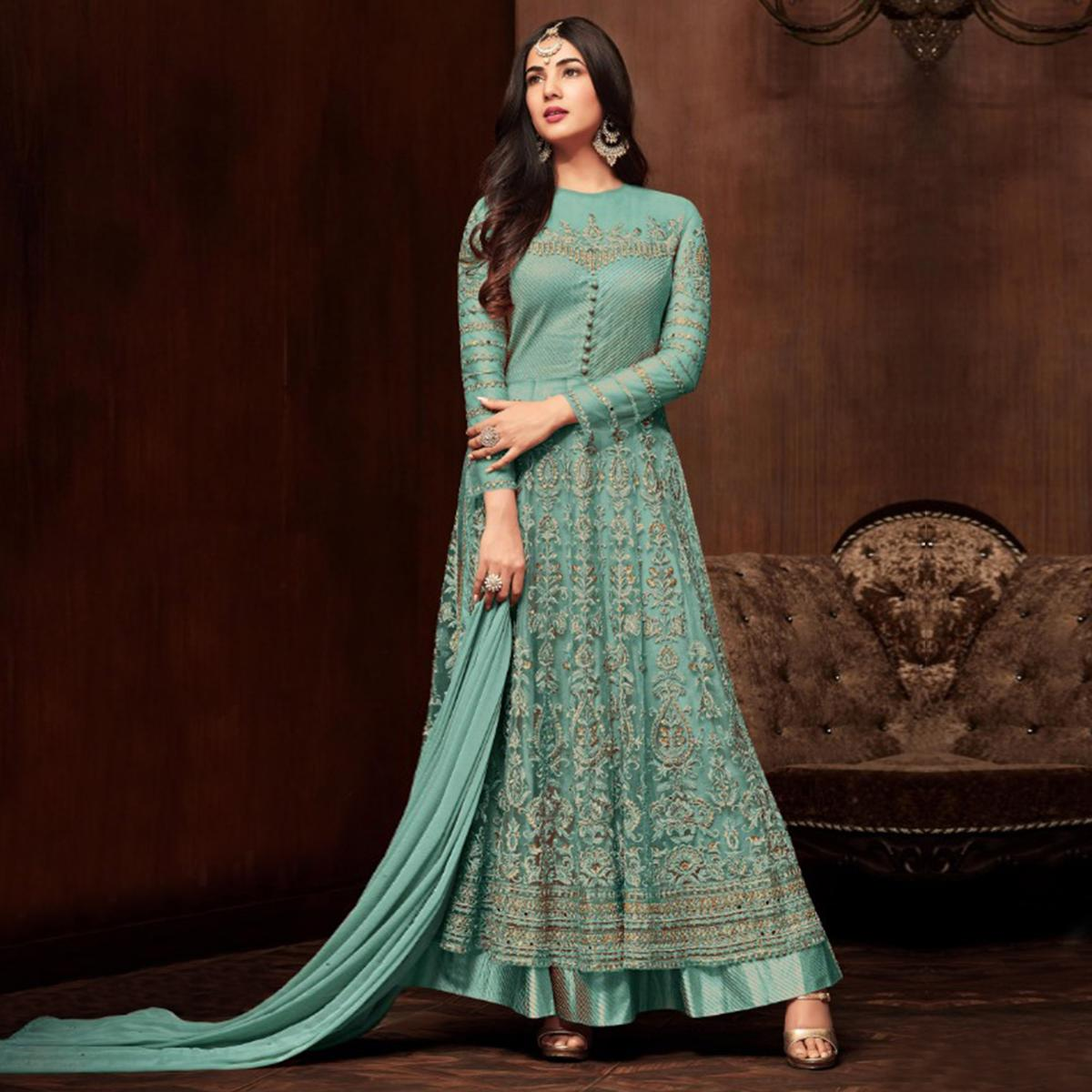 Fantastic Aqua Green Colored Partywear Embroidered Netted Lehenga Kameez