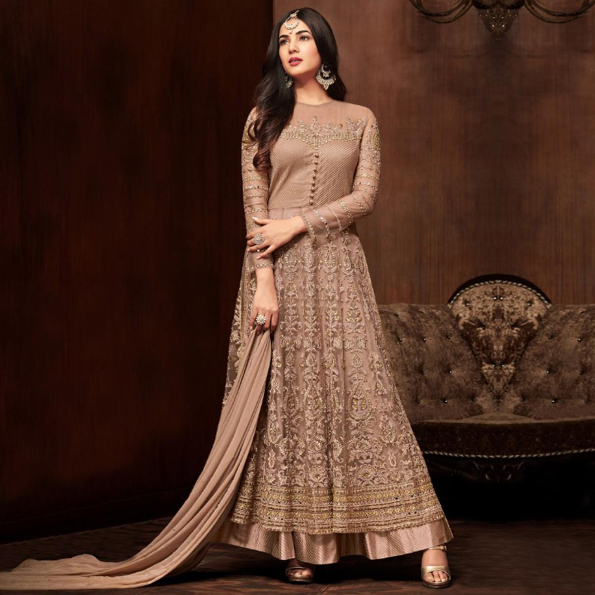 Amazing Brown Colored Partywear Embroidered Netted Lehenga Kameez