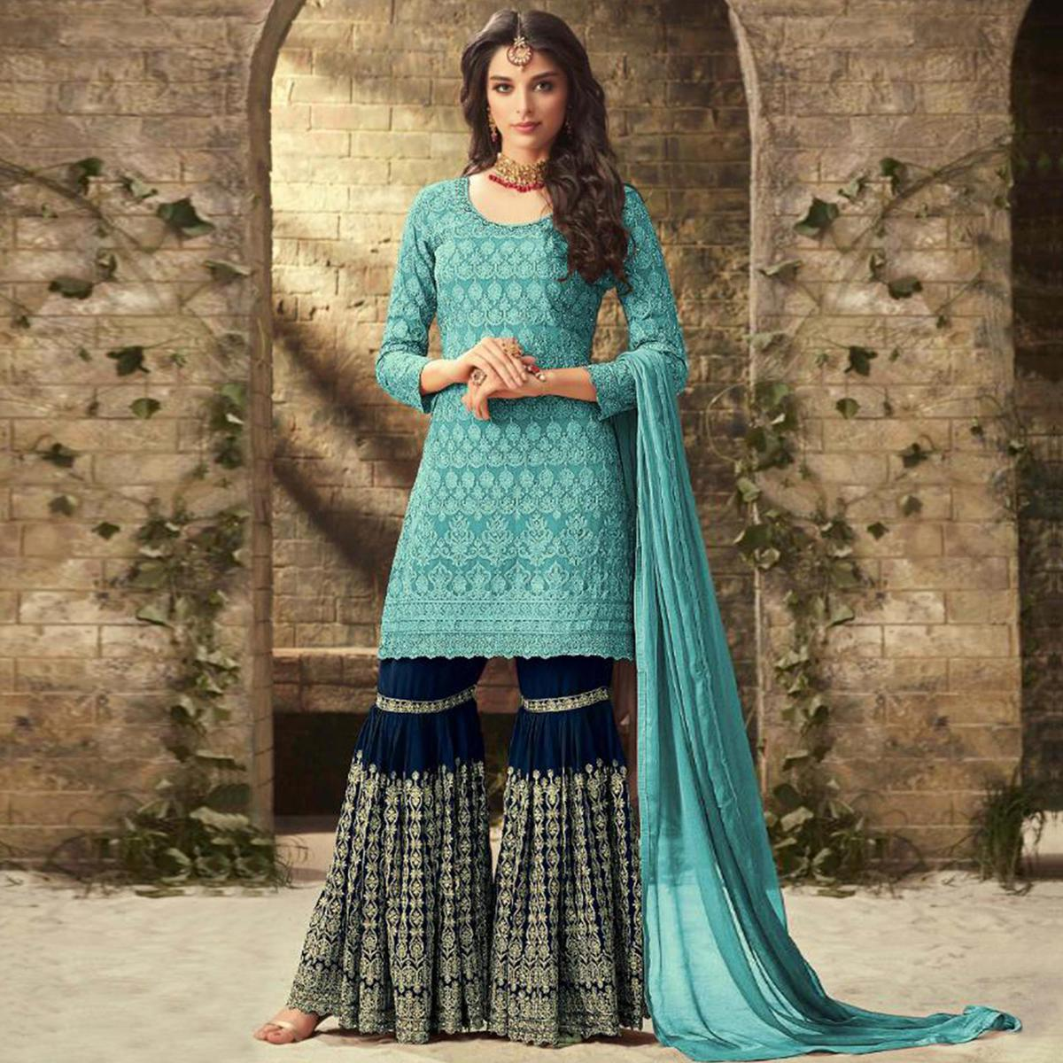 Refreshing Sky Blue Colored Partywear Embroidered Faux Georgette Palazzo Suit