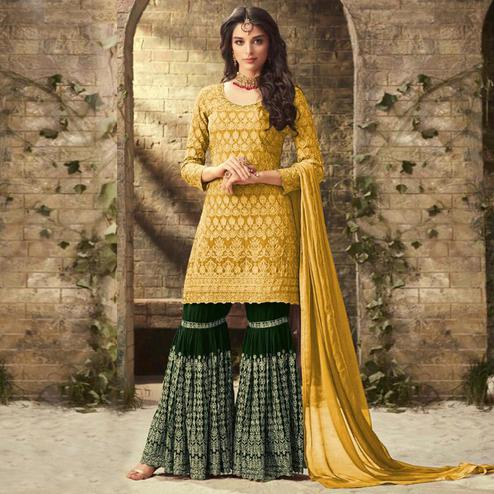 Demanding Yellow Colored Partywear Embroidered Faux Georgette Palazzo Suit