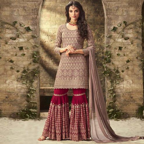 Beautiful Brown Colored Partywear Embroidered Faux Georgette Palazzo Suit