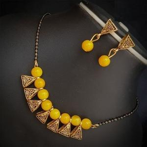 Classy Yellow Colored Moti Work Brass & Pearl Mangalsutra Set