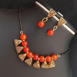 Graceful Orange Colored Moti Work Brass & Pearl Mangalsutra Set