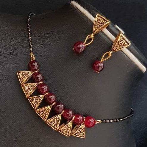 Delightful Maroon Colored Moti Work Brass & Pearl Mangalsutra Set