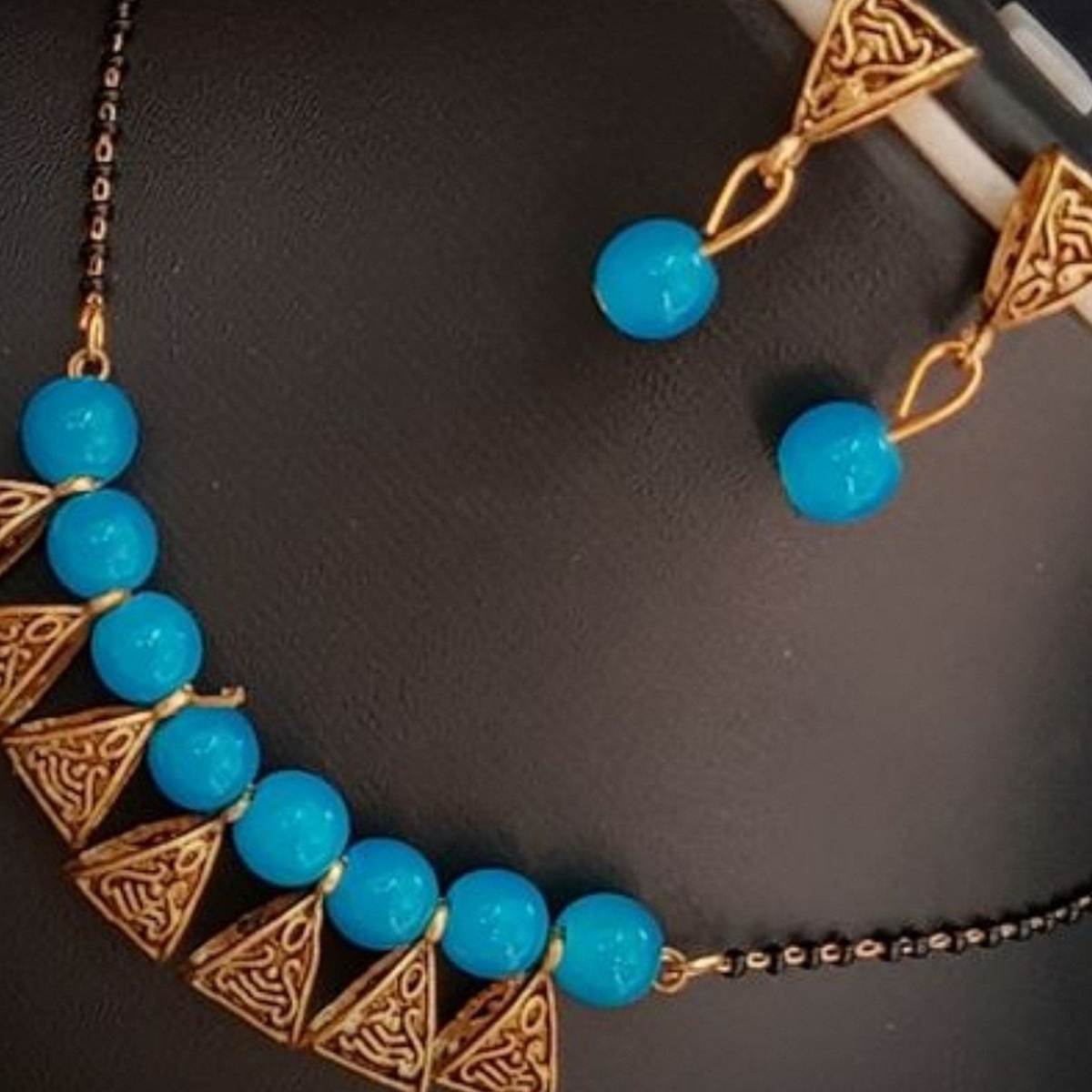 Amazing Light Blue Colored Moti Work Brass & Pearl Mangalsutra Set
