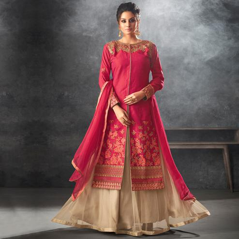 Sophisticated Dark Pink Colored Partywear Embroidered Art Silk Lehenga Kameez