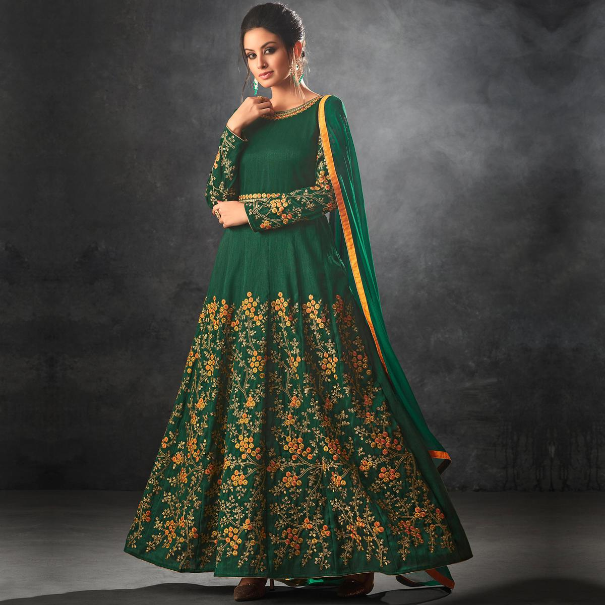 Blooming Dark Green Colored Partywear Embroidered Art Silk Anarkali Suit