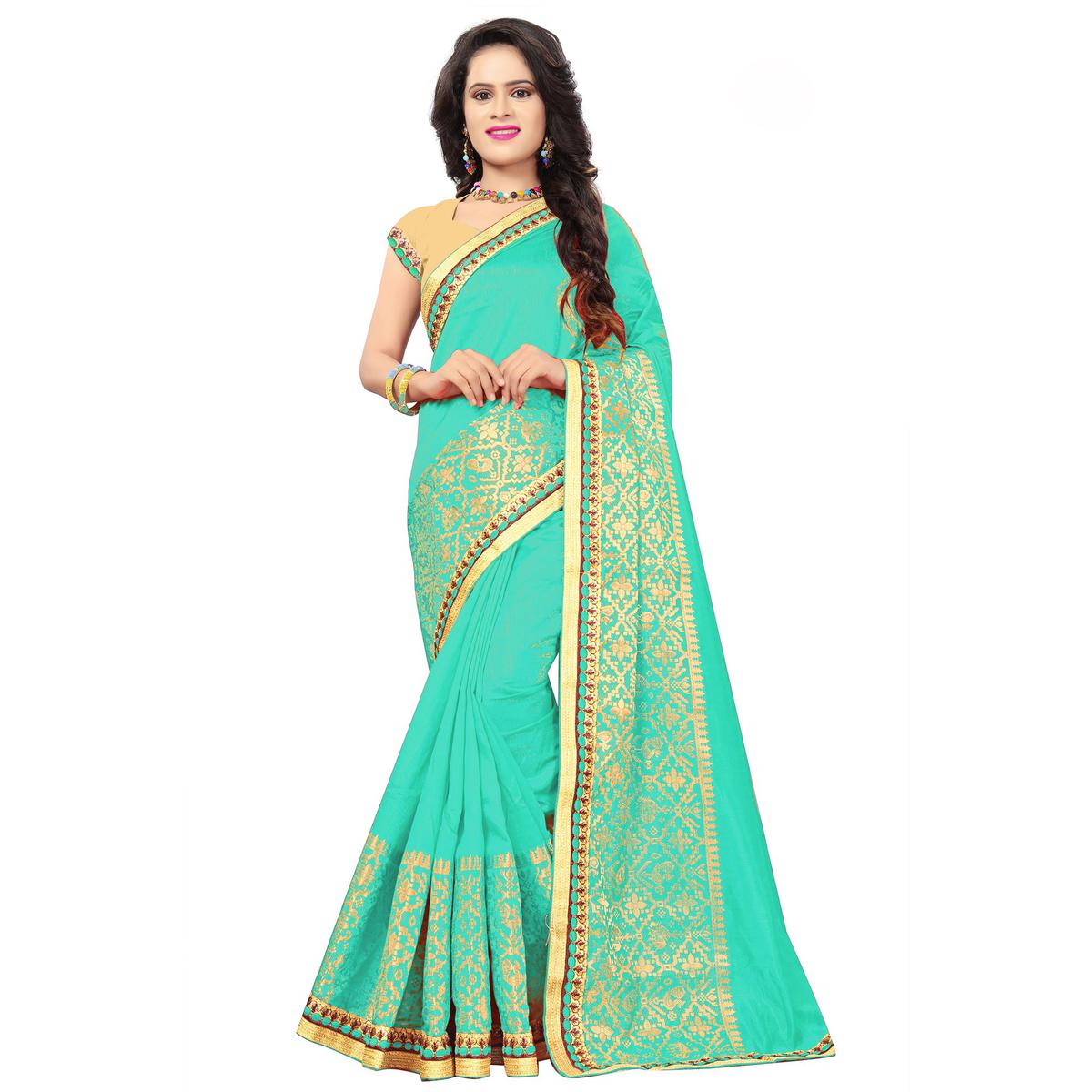 Classy Turquoise Green Colored Festive Wear Woven Silk Saree