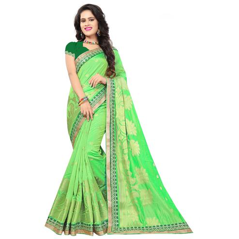 Pretty Light Green Colored Festive Wear Woven Silk Saree