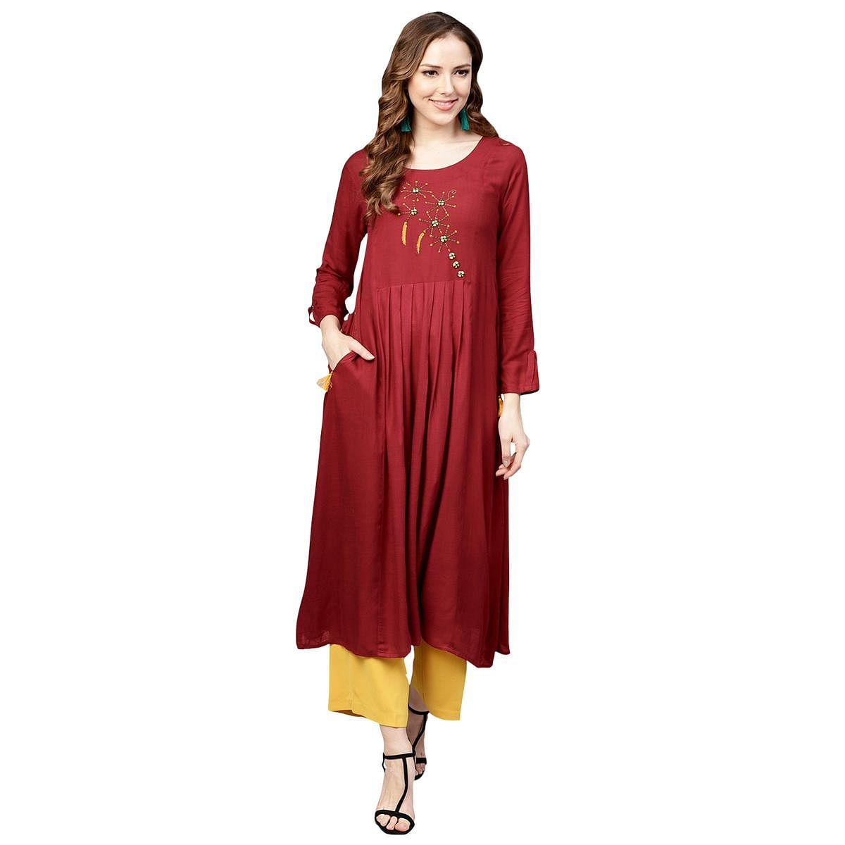 Refreshing Maroon Colored Casual Wear Embroidered Rayon Kurti