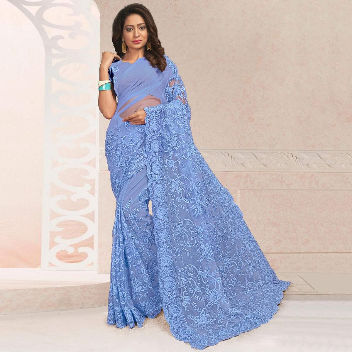 Adorning Blue Colored Party Wear Embroidered Net Saree
