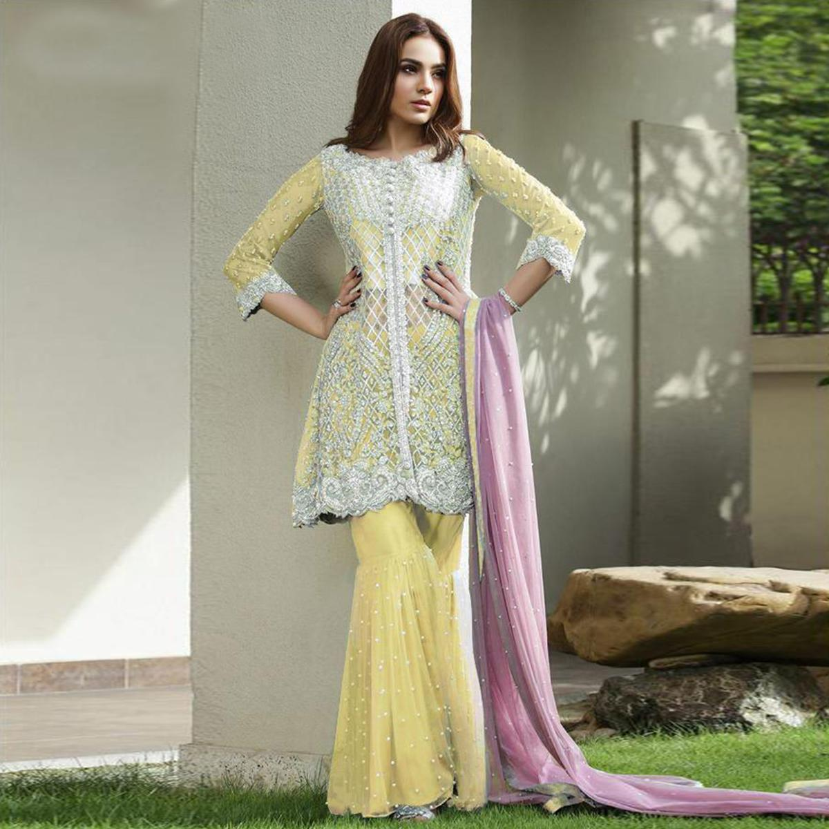 Prominent Yellow Colored Partywear Embroidered Netted Palazzo Suit