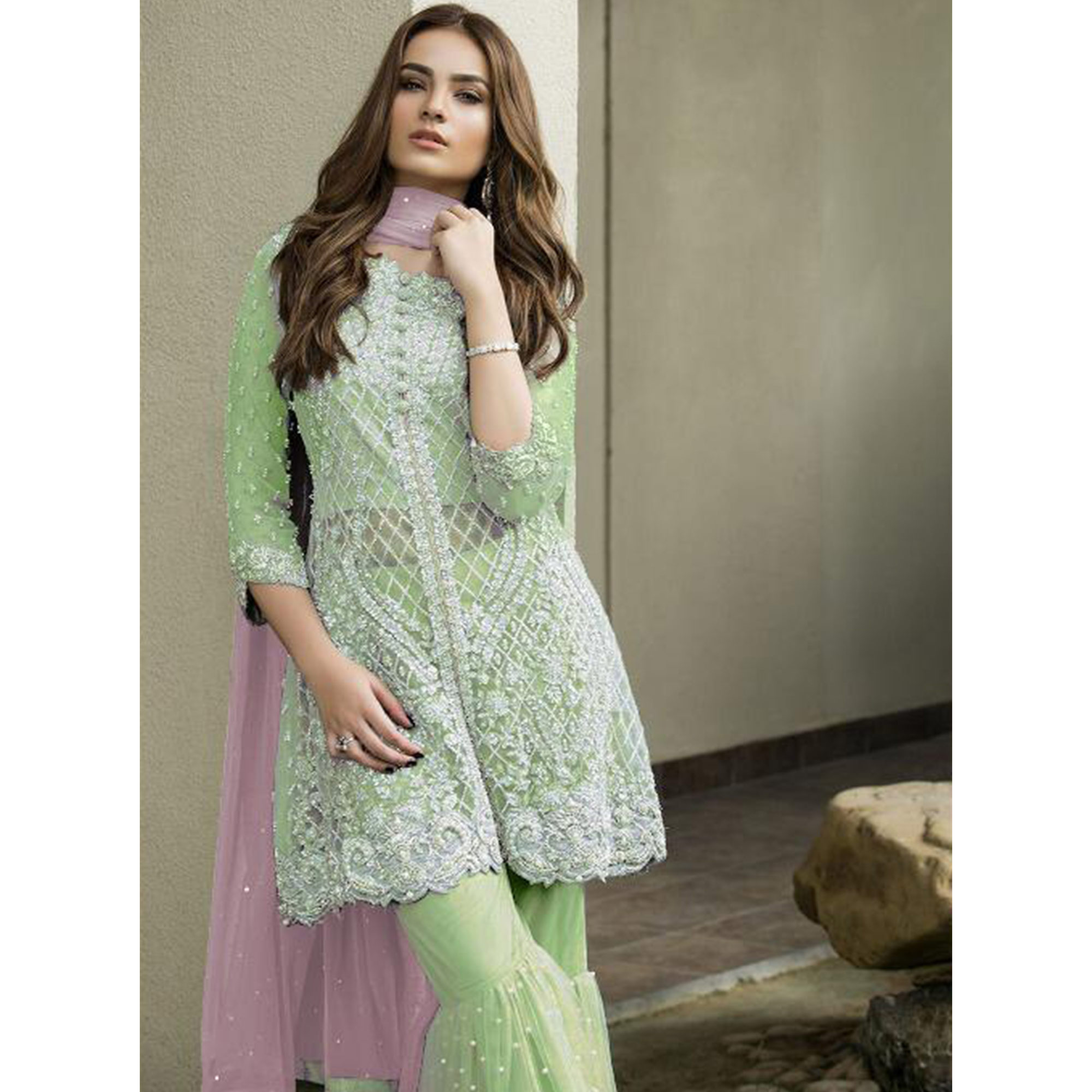 Adorning Green Colored Partywear Embroidered Netted Palazzo Suit