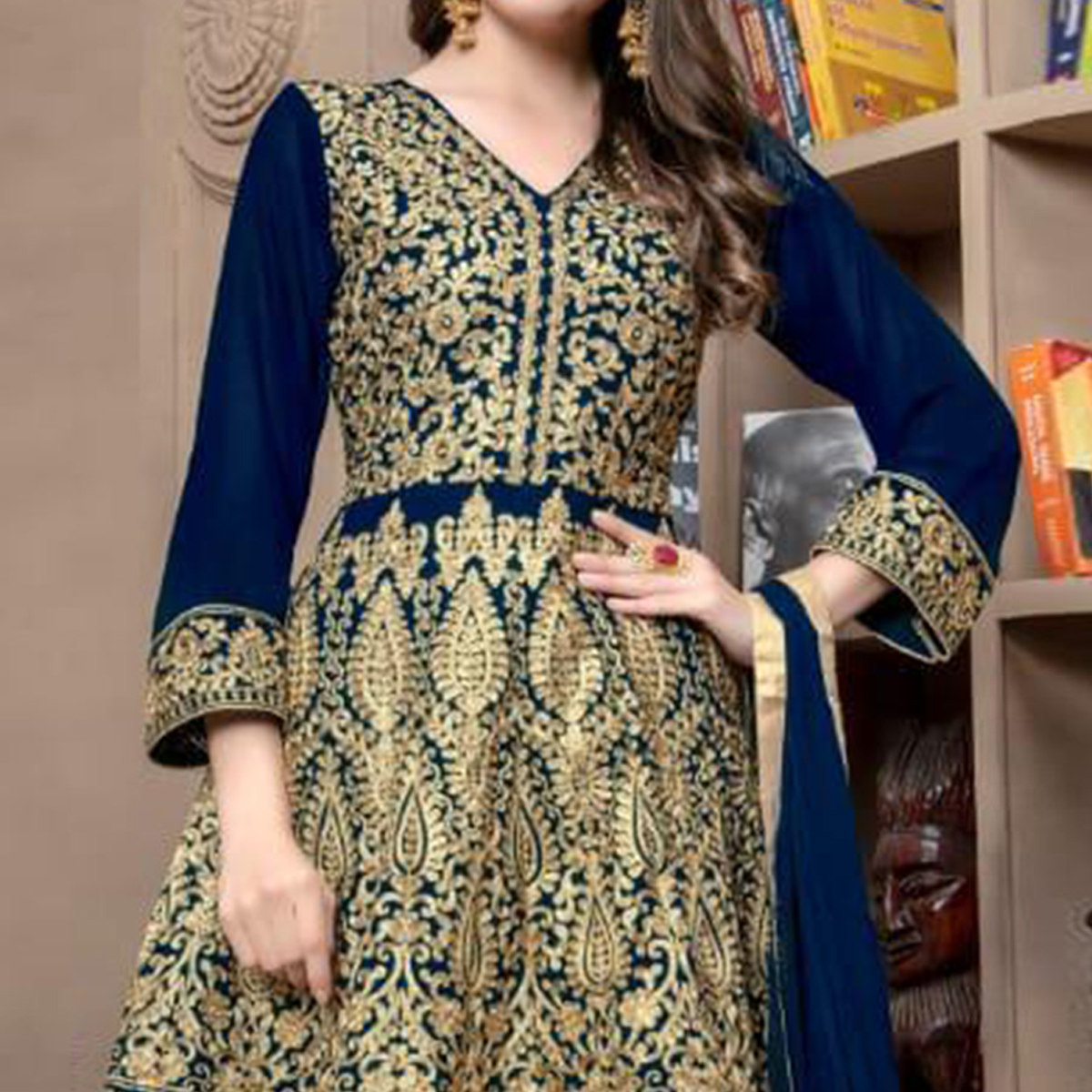 Gorgeous Navy Blue Colored Partywear Embroidered Faux Georgette Palazzo Suit