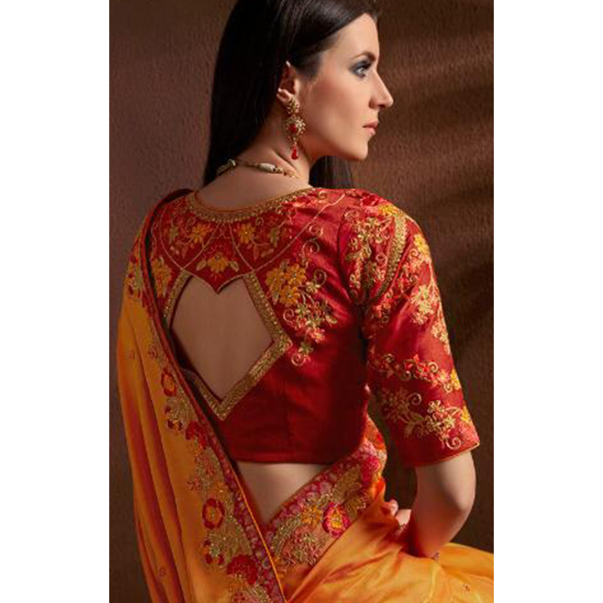 Alluring Orange Colored Party Wear Embroidered Georgette Saree