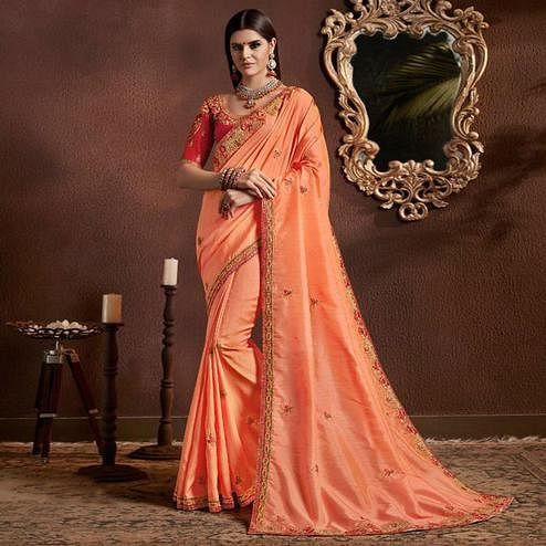 Opulent Peach Colored Party Wear Embroidered Georgette Saree