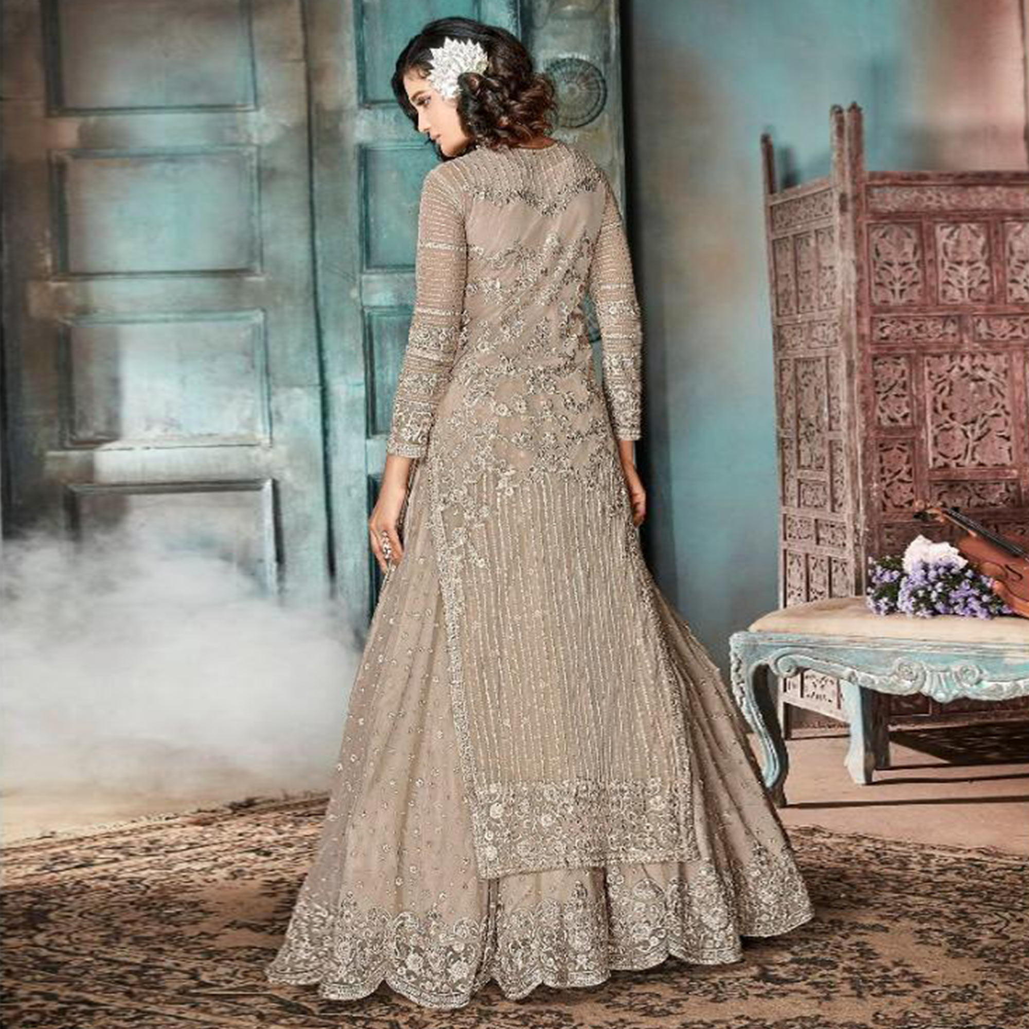 Innovative Dark Beige Colored Party Wear Embroidered Net Lehenga Suit