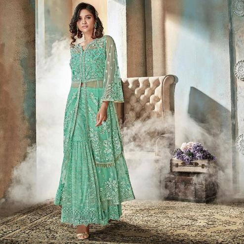 Captivating Sea Green Colored Party Wear Embroidered Jacquard & Net Lehenga Suit
