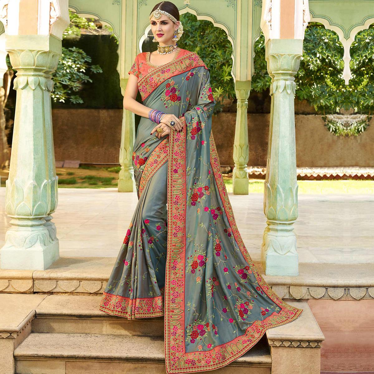 Gleaming Grey Colored Party Wear Embroidered Raw Silk Saree