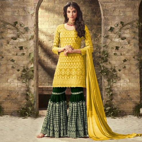 Marvellous Yellow Colored Partywear Embroidered Faux Georgette Palazzo Suit