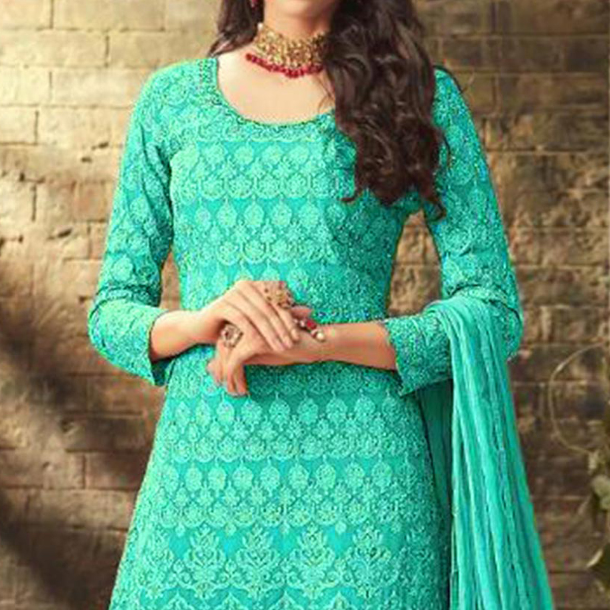 Amazing Sky Blue Colored Partywear Embroidered Faux Georgette Palazzo Suit