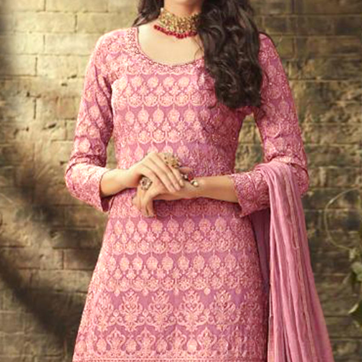 Stunning Pink Colored Partywear Embroidered Faux Georgette Palazzo Suit