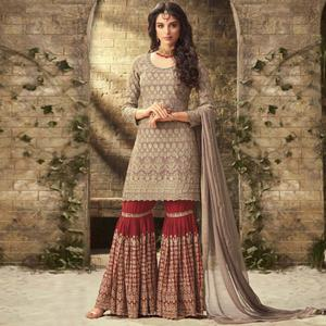 Gorgeous Brown Colored Partywear Embroidered Faux Georgette Palazzo Suit